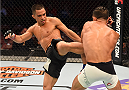 HOUSTON, TX - OCTOBER 03:  (L-R) Chris Cariaso kicks Sergio Pettis in their flyweight bout during the UFC 192 event at the Toyota Center on October 3, 2015 in Houston, Texas. (Photo by Josh Hedges/Zuffa LLC/Zuffa LLC via Getty Images)