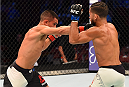 HOUSTON, TX - OCTOBER 03:  (L-R) Chris Cariaso punches Sergio Pettis in their flyweight bout during the UFC 192 event at the Toyota Center on October 3, 2015 in Houston, Texas. (Photo by Josh Hedges/Zuffa LLC/Zuffa LLC via Getty Images)