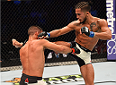 HOUSTON, TX - OCTOBER 03:  (R-L) Sergio Pettis kicks Chris Cariaso in their flyweight bout during the UFC 192 event at the Toyota Center on October 3, 2015 in Houston, Texas. (Photo by Josh Hedges/Zuffa LLC/Zuffa LLC via Getty Images)