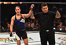 HOUSTON, TX - OCTOBER 03:  A point is taken away from Jessica Eye for kneeing Julianna Pena in their women's bantamweight bout during the UFC 192 event at the Toyota Center on October 3, 2015 in Houston, Texas. (Photo by Josh Hedges/Zuffa LLC/Zuffa LLC via Getty Images)