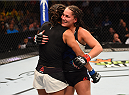 HOUSTON, TX - OCTOBER 03:  (L-R) Julianna Pena and Jessica Eye hug at the end of their women's bantamweight bout during the UFC 192 event at the Toyota Center on October 3, 2015 in Houston, Texas. (Photo by Josh Hedges/Zuffa LLC/Zuffa LLC via Getty Images)