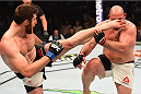 HOUSTON, TX - OCTOBER 03:  (L-R) Ruslan Magomedov kicks Shawn Jordan in their heavyweight bout during the UFC 192 event at the Toyota Center on October 3, 2015 in Houston, Texas. (Photo by Josh Hedges/Zuffa LLC/Zuffa LLC via Getty Images)