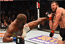 HOUSTON, TX - OCTOBER 03:  (L-R) Rashad Evans kicks Ryan Bader in their light heavyweight bout during the UFC 192 event at the Toyota Center on October 3, 2015 in Houston, Texas. (Photo by Josh Hedges/Zuffa LLC/Zuffa LLC via Getty Images)