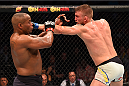 HOUSTON, TX - OCTOBER 03:  (R-L) Alexander Gustafsson punches Daniel Cormier in their UFC light heavyweight championship bout during the UFC 192 event at the Toyota Center on October 3, 2015 in Houston, Texas. (Photo by Josh Hedges/Zuffa LLC/Zuffa LLC via Getty Images)