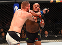 HOUSTON, TX - OCTOBER 03:  (R-L) Daniel Cormier elbows Alexander Gustafsson in their UFC light heavyweight championship bout during the UFC 192 event at the Toyota Center on October 3, 2015 in Houston, Texas. (Photo by Josh Hedges/Zuffa LLC/Zuffa LLC via Getty Images)
