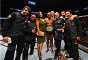HOUSTON, TX - OCTOBER 03:  Daniel Cormier celebrates his victory over Alexander Gustafsson in their UFC light heavyweight championship bout with his team during the UFC 192 event at the Toyota Center on October 3, 2015 in Houston, Texas. (Photo by Josh Hedges/Zuffa LLC/Zuffa LLC via Getty Images)