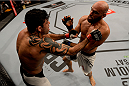 SAO PAULO, BRAZIL - NOVEMBER 07: Viscardi Andrade of Brazil punches Gasan Umalatov of Russia in their welterweight bout during UFC Fight Nigth Belfort v Henderson at Ibirapuera Gymnasium on November 7, 2015 in Sao Paulo, Brazil. (Photo by Buda Mendes/Zuffa LLC/Zuffa LLC via Getty Images)