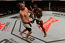 SAO PAULO, BRAZIL - NOVEMBER 07:  Corey Anderson of the United States punches Fabio Maldonado of Brazil in their light heavyweight bout   during the UFC Fight Night Belfort v Henderson at Ibirapuera Gymnasium on November 7, 2015 in Sao Paulo, Brazil.  (Photo by Buda Mendes/Zuffa LLC/Zuffa LLC via Getty Images)