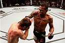 SAO PAULO, BRAZIL - NOVEMBER 07:  Alex Oliveira of Brazil punches Piotr Hallmann of Poland in their lightweight bout during the UFC Fight Night Belfort v Henderson at Ibirapuera Gymnasium on November 7, 2015 in Sao Paulo, Brazil.  (Photo by Buda Mendes/Zuffa LLC/Zuffa LLC via Getty Images)
