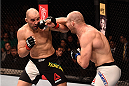 SAO PAULO, BRAZIL - NOVEMBER 07:  Patrick Cummins of the United States punches Glover Teixeira of Brazil in their light heavyweight bout during the UFC Fight Night Belfort v Henderson at Ibirapuera Gymnasium on November 7, 2015 in Sao Paulo, Brazil.  (Photo by Buda Mendes/Zuffa LLC/Zuffa LLC via Getty Images)