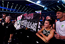 MELBOURNE, AUSTRALIA - NOVEMBER 15: Fans hold a sign that reads 