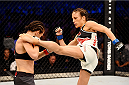 MELBOURNE, AUSTRALIA - NOVEMBER 15:  Valerie Letourneau (R) lands a left-leg kick against Joanna Jedrzejczyk (L) in their UFC women's strawweight championship bout during the UFC 193 event at Etihad Stadium on November 15, 2015 in Melbourne, Australia.  (Photo by Josh Hedges/Zuffa LLC/Zuffa LLC via Getty Images)