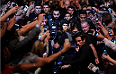 MELBOURNE, AUSTRALIA - NOVEMBER 15:  Ronda Rousey walks to the Octagon surrounded by fans before facing Holly Holm (not pictured) in their UFC women's bantamweight championship bout during the UFC 193 event at Etihad Stadium on November 15, 2015 in Melbourne, Australia.  (Photo by Josh Hedges/Zuffa LLC/Zuffa LLC via Getty Images)