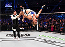 MELBOURNE, AUSTRALIA - NOVEMBER 15:  Holly Holm does a back-flip in celebrateion of her second round KO (head kick and punches) over Ronda Rousey (not pictured) to win their UFC women's bantamweight championship bout during the UFC 193 event at Etihad Stadium on November 15, 2015 in Melbourne, Australia.  (Photo by Josh Hedges/Zuffa LLC/Zuffa LLC via Getty Images)