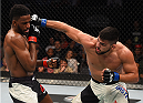 MONTERREY, MEXICO - NOVEMBER 21:  (R-L) Kelvin Gastelum of the United States punches Neil Magny of the United States in their welterweight bout during the UFC Fight Night event at Arena Monterrey on November 21, 2015 in Monterrey, Mexico.  (Photo by Jeff Bottari/Zuffa LLC/Zuffa LLC via Getty Images)