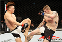 SEOUL, SOUTH KOREA - NOVEMBER 28: Jake Collier of the United States of America kicks Dongi Yang of South Korea in their  middleweight bout during the UFC Fight Night at the Olympic Park Gymnastics Arena on November 28, 2015 in Seoul, South Korea. (Photo by Mitch Viquez/Zuffa LLC/Zuffa LLC via Getty Images)