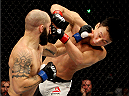 SEOUL, SOUTH KOREA - NOVEMBER 28: Sam Sicilia of the United States of America punches Doo Ho Choi of South Korea in their  featherweight bout during the UFC Fight Night at the Olympic Park Gymnastics Arena on November 28, 2015 in Seoul, South Korea. (Photo by Mitch Viquez/Zuffa LLC/Zuffa LLC via Getty Images)