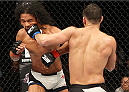 SEOUL, SOUTH KOREA - NOVEMBER 28:  Jorge Masvidal of the United States of America punches Benson Henderson of the United States of America in their welterweight bout during the UFC Fight Night at the Olympic Park Gymnastics Arena on November 28, 2015 in Seoul, South Korea. (Photo by Mitch Viquez/Zuffa LLC/Zuffa LLC via Getty Images)