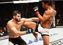 SEOUL, SOUTH KOREA - NOVEMBER 28: Benson Henderson of the United States of America throws a jumping knee at Jorge Masvidal of the United States of America in their welterweight bout during the UFC Fight Night at the Olympic Park Gymnastics Arena on November 28, 2015 in Seoul, South Korea. (Photo by Mitch Viquez/Zuffa LLC/Zuffa LLC via Getty Images)
