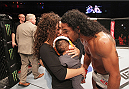 SEOUL, SOUTH KOREA - NOVEMBER 28:  Benson Henderson of the United States of America celebrates with his family after his win over Jorge Masvidal of the United States of America in their welterweight bout during the UFC Fight Night at the Olympic Park Gymnastics Arena on November 28, 2015 in Seoul, South Korea. (Photo by Mitch Viquez/Zuffa LLC/Zuffa LLC via Getty Images)