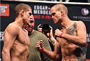 LAS VEGAS, NV - DECEMBER 10:  (L-R) Opponents Joe Lauzon and Evan Dunham face off during the UFC weigh-in inside MGM Grand Garden Arena on December 10, 2015 in Las Vegas, Nevada.  (Photo by Josh Hedges/Zuffa LLC/Zuffa LLC via Getty Images)