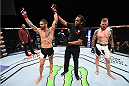 LAS VEGAS, NEVADA - DECEMBER 10:  (L) Santiago Ponzinibbio celebrates his win over Andreas Stahl in their welterweight bout during the UFC Fight Night event at The Chelsea at the Cosmopolitan of Las Vegas on December 10, 2015 in Las Vegas, Nevada.  (Photo by Jeff Bottari/Zuffa LLC/Zuffa LLC via Getty Images)