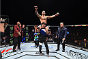 LAS VEGAS, NEVADA - DECEMBER 10:  Santiago Ponzinibbio celebrates his win over Andreas Stahl in their welterweight bout during the UFC Fight Night event at The Chelsea at the Cosmopolitan of Las Vegas on December 10, 2015 in Las Vegas, Nevada.  (Photo by Jeff Bottari/Zuffa LLC/Zuffa LLC via Getty Images)