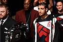 LAS VEGAS, NEVADA - DECEMBER 10:  Elias Theodorou enters the arena for his middleweight bout against Thiago Santos during the UFC Fight Night event at The Chelsea at the Cosmopolitan of Las Vegas on December 10, 2015 in Las Vegas, Nevada.  (Photo by Jeff Bottari/Zuffa LLC/Zuffa LLC via Getty Images)