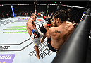 LAS VEGAS, NEVADA - DECEMBER 10:  (L) Thiago Santos kicks Elias Theodorou in their middleweight bout during the UFC Fight Night event at The Chelsea at the Cosmopolitan of Las Vegas on December 10, 2015 in Las Vegas, Nevada.  (Photo by Jeff Bottari/Zuffa LLC/Zuffa LLC via Getty Images)