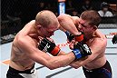 LAS VEGAS, NV - DECEMBER 11: (R-L) Joe Lauzon elbows Evan Dunham in their lightweight bout during the TUF Finale event inside The Chelsea at The Cosmopolitan of Las Vegas on December 11, 2015 in Las Vegas, Nevada.  (Photo by Jeff Bottari/Zuffa LLC/Zuffa LLC via Getty Images) *** Local Caption *** Joe Lauzon; Evan Dunham