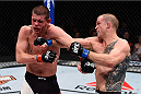 LAS VEGAS, NV - DECEMBER 11: (R-L) Evan Dunham punches Joe Lauzon in their lightweight bout during the TUF Finale event inside The Chelsea at The Cosmopolitan of Las Vegas on December 11, 2015 in Las Vegas, Nevada.  (Photo by Jeff Bottari/Zuffa LLC/Zuffa LLC via Getty Images) *** Local Caption *** Joe Lauzon; Evan Dunham