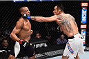 LAS VEGAS, NV - DECEMBER 11: (R-L) Tony Ferguson punches Edson Barboza in their lightweight bout during the TUF Finale event inside The Chelsea at The Cosmopolitan of Las Vegas on December 11, 2015 in Las Vegas, Nevada.  (Photo by Jeff Bottari/Zuffa LLC/Zuffa LLC via Getty Images) *** Local Caption *** Edson Barboza; Tony Ferguson