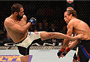 LAS VEGAS, NV - DECEMBER 12: (L-R) Frankie Saenz kicks Urijah Faber in their bantamweight bout during the UFC 194 event inside MGM Grand Garden Arena on December 12, 2015 in Las Vegas, Nevada.  (Photo by Josh Hedges/Zuffa LLC/Zuffa LLC via Getty Images) *** Local Caption *** Urijah Faber; Frankie Saenz