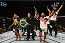 LAS VEGAS, NV - DECEMBER 12:  Yoel Romero of Cuba (right) reacts after being declared the winner over Ronaldo 'Jacare' Souza (left) in their middleweight bout during the UFC 194 event inside MGM Grand Garden Arena on December 12, 2015 in Las Vegas, Nevada.  (Photo by Josh Hedges/Zuffa LLC/Zuffa LLC via Getty Images) *** Local Caption *** Ronaldo Souza; Yoel Romero