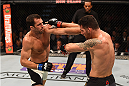 LAS VEGAS, NV - DECEMBER 12: (L-R) Luke Rockhold punches Chris Weidman in their UFC middleweight championship bout during the UFC 194 event inside MGM Grand Garden Arena on December 12, 2015 in Las Vegas, Nevada.  (Photo by Josh Hedges/Zuffa LLC/Zuffa LLC via Getty Images) *** Local Caption *** Chris Weidman; Luke Rockhold