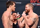 ORLANDO, FL - DECEMBER 18:   (L-R) Opponents CB Dollaway and Nate Marquardt face off during the UFC weigh-in at the Orange County Convention Center on December 18, 2015 in Orlando, Florida. (Photo by Josh Hedges/Zuffa LLC/Zuffa LLC via Getty Images)