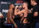 ORLANDO, FL - DECEMBER 18:  (L-R) Opponents Michael Johnson and Nate Diaz face off during the UFC weigh-in at the Orange County Convention Center on December 18, 2015 in Orlando, Florida. (Photo by Josh Hedges/Zuffa LLC/Zuffa LLC via Getty Images)