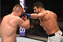 ORLANDO, FL - DECEMBER 19:   (R-L) Danny Castillo punches Nik Lentz in their lightweight bout during the UFC Fight Night event at the Amway Center on December 19, 2015 in Orlando, Florida. (Photo by Josh Hedges/Zuffa LLC/Zuffa LLC via Getty Images)