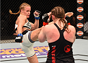ORLANDO, FL - DECEMBER 19:   (L-R) Valentina Shevchenko kicks Sarah Kaufman in their women's bantamweight bout during the UFC Fight Night event at the Amway Center on December 19, 2015 in Orlando, Florida. (Photo by Josh Hedges/Zuffa LLC/Zuffa LLC via Getty Images)