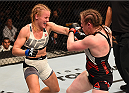 ORLANDO, FL - DECEMBER 19:   (L-R) Valentina Shevchenko punches Sarah Kaufman in their women's bantamweight bout during the UFC Fight Night event at the Amway Center on December 19, 2015 in Orlando, Florida. (Photo by Josh Hedges/Zuffa LLC/Zuffa LLC via Getty Images)