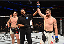 ORLANDO, FL - DECEMBER 19:   (R-L) Nate Marquardt celebrates his knockout victory over CB Dollaway in their middleweight bout during the UFC Fight Night event at the Amway Center on December 19, 2015 in Orlando, Florida. (Photo by Josh Hedges/Zuffa LLC/Zuffa LLC via Getty Images)