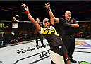 ORLANDO, FL - DECEMBER 19:   Charles Oliveira celebrates his submission victory over Myles Jury in their featherweight bout during the UFC Fight Night event at the Amway Center on December 19, 2015 in Orlando, Florida. (Photo by Josh Hedges/Zuffa LLC/Zuffa LLC via Getty Images)