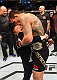 ORLANDO, FL - DECEMBER 19:   Rafael dos Anjos hugs his son and celebrates his TKO victory over Donald Cerrone in their UFC lightweight title bout during the UFC Fight Night event at the Amway Center on December 19, 2015 in Orlando, Florida. (Photo by Josh Hedges/Zuffa LLC/Zuffa LLC via Getty Images)