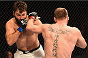 LAS VEGAS, NV - JANUARY 02: (L-R) Andrei Arlovski punches Stipe Miocic in their heavyweight bout during the UFC 195 event inside MGM Grand Garden Arena on January 2, 2016 in Las Vegas, Nevada.  (Photo by Josh Hedges/Zuffa LLC/Zuffa LLC via Getty Images)