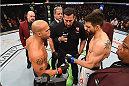 LAS VEGAS, NV - JANUARY 02: Robbie Lawler (left) and Carlos Condit (right) touch gloves in their UFC welterweight championship bout during the UFC 195 event inside MGM Grand Garden Arena on January 2, 2016 in Las Vegas, Nevada.  (Photo by Josh Hedges/Zuffa LLC/Zuffa LLC via Getty Images)