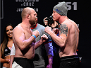 BOSTON, MA - JANUARY 16:  (L-R) Opponents Tim Boetsch and Ed Herman of France face off during the UFC weigh-in at the Wang Theatre on January 16, 2016 in Boston, Massachusetts. (Photo by Jeff Bottari/Zuffa LLC/Zuffa LLC via Getty Images)