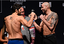 BOSTON, MA - JANUARY 16:  (L-R) Opponents Patrick Cote of Canada and Ben Saunders face off during the UFC weigh-in at the Wang Theatre on January 16, 2016 in Boston, Massachusetts. (Photo by Jeff Bottari/Zuffa LLC/Zuffa LLC via Getty Images)