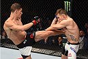BOSTON, MA - JANUARY 17:  (L-R) Charles Rosa kicks Kyle Bochniak in their featherweight bout during the UFC Fight Night event inside TD Garden on January 17, 2016 in Boston, Massachusetts. (Photo by Jeff Bottari/Zuffa LLC/Zuffa LLC via Getty Images)