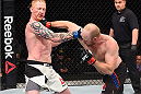 BOSTON, MA - JANUARY 17:  (R-L) Tim Boetsch punches Ed Herman in their light heavyweight bout during the UFC Fight Night event inside TD Garden on January 17, 2016 in Boston, Massachusetts. (Photo by Jeff Bottari/Zuffa LLC/Zuffa LLC via Getty Images)