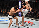 BOSTON, MA - JANUARY 17:  (R-L) Ben Saunders kicks Patrick Cote of Canada in their welterweight bout during the UFC Fight Night event inside TD Garden on January 17, 2016 in Boston, Massachusetts. (Photo by Jeff Bottari/Zuffa LLC/Zuffa LLC via Getty Images)